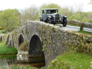 aston martin lagondas at lobhill farmhouse on the bridge